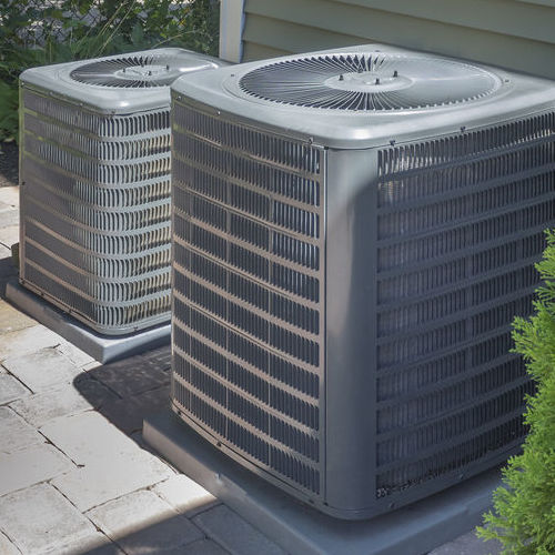 Two Air Conditioning Units Undergoing AC Maintenance